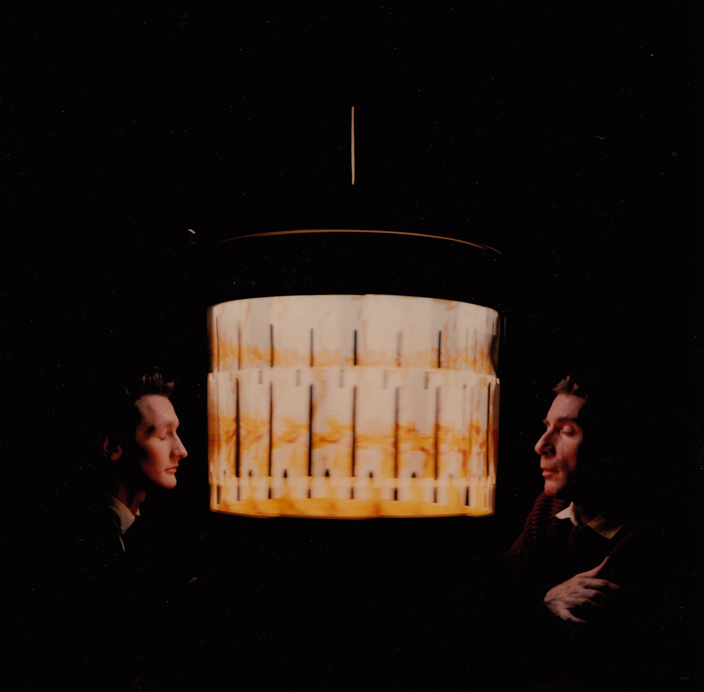 Photograph of Brion Gysin and Ian Sommerville sitting on either side of a dream machine. Date and photographer unknown. (MSS 11975. Tunstall Fund, 2000/2001. Image by Petrina Jackson)