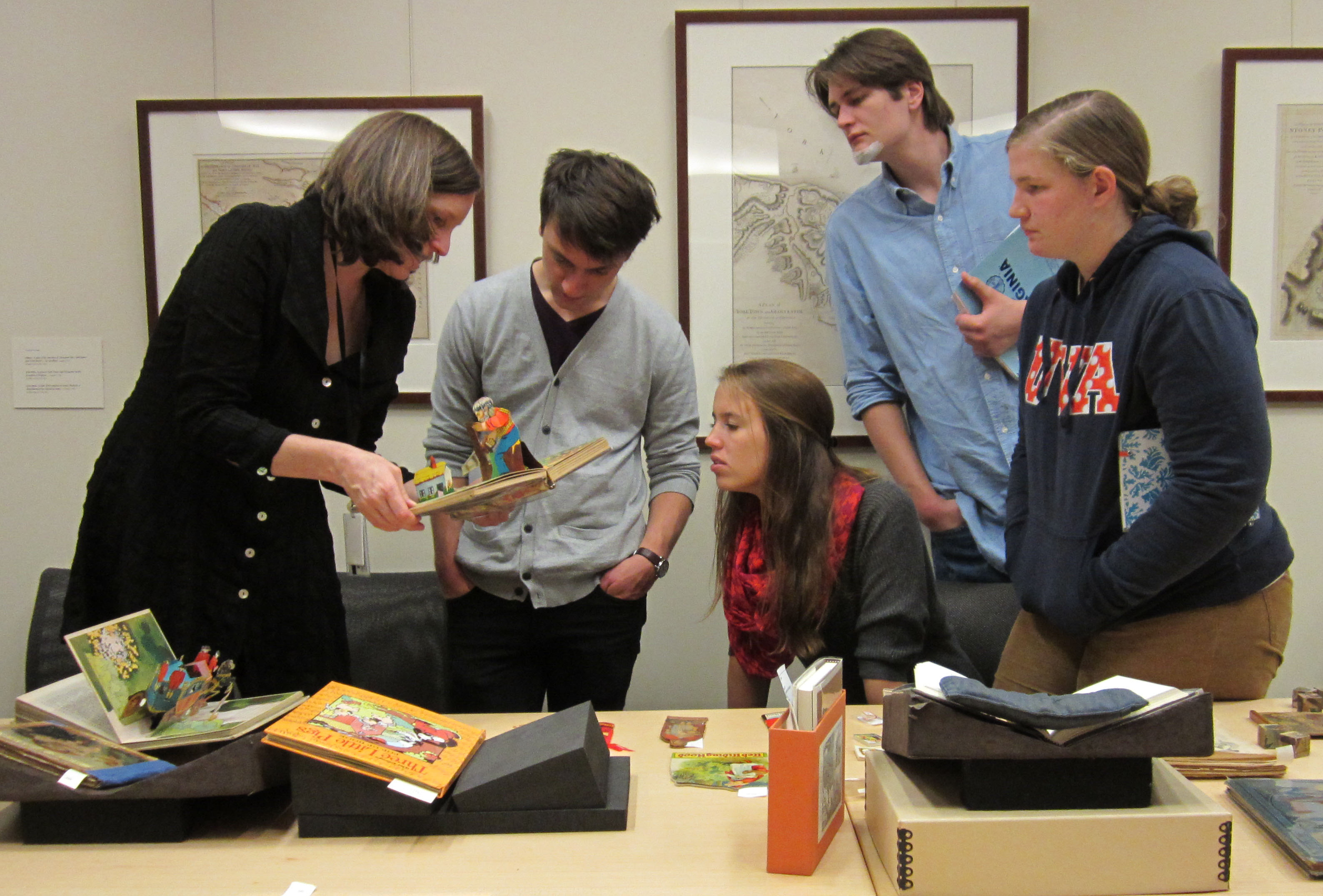 Molly and the students take a closer look at pop-up books. (Photograph by Petrina Jackson)