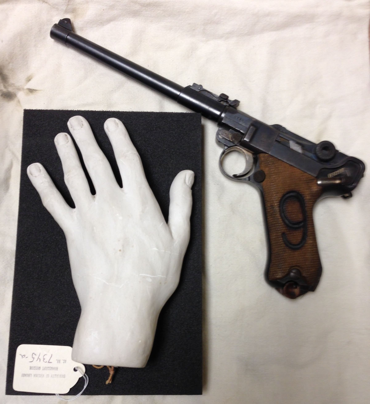 Mold of John Powell's hand and German Luger, 1917 (Image by Caroline Newcomb)