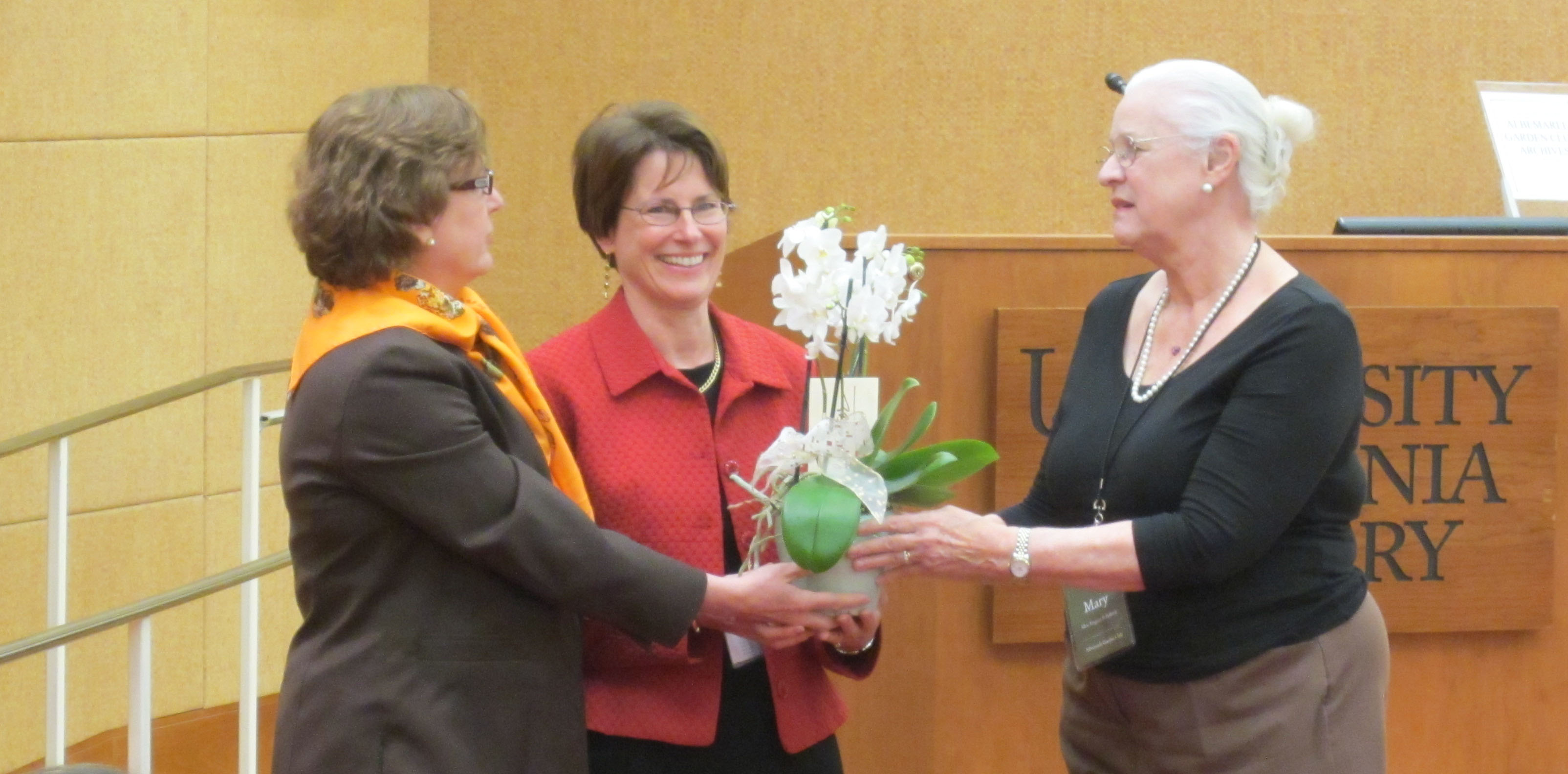 AGC members present Special Collections Head of Researcher and Reference Services Heather Riser with a for her tireless work in assisting the club with their 100 Anniversary program. (Photograph by Petrina Jackson)