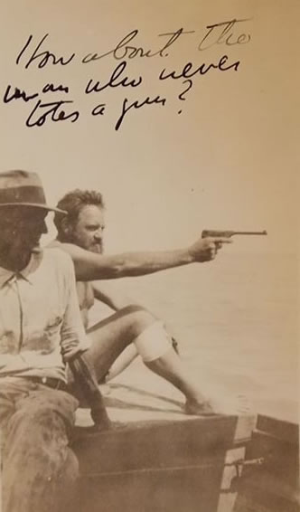 "Waldo Peirce with unidentified man (photographer not identified). The writing reads ""How about a man who never totes a gun?"" (MSS 8402, Clifton Waller Barrett Library of American Literature. Image by Ethan King)"