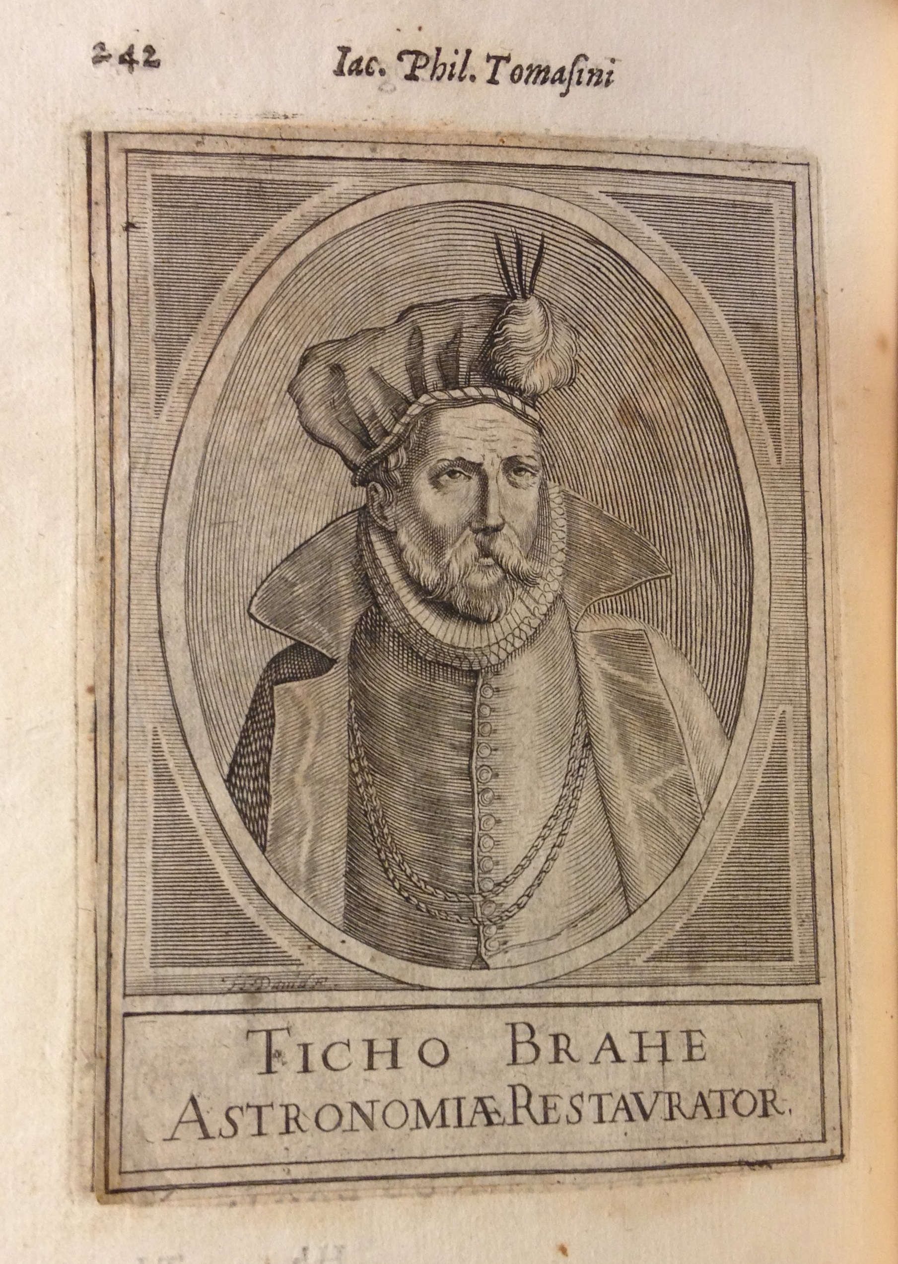 A stellar eclipse! This engraved portrait of astronomer Tycho Brahe is actually a cancel slip pasted over another engraved portrait inadvertently printed on the wrong leaf. Note how the lower left corner is lifting upward, and the engraved border of the underlying portrait visible at left. Giacomo Filippo Tomasini, Illustrium virorum elogia iconibus illustrata (Padua, 1630), p. 242.   (CT1122 .T6 1630)