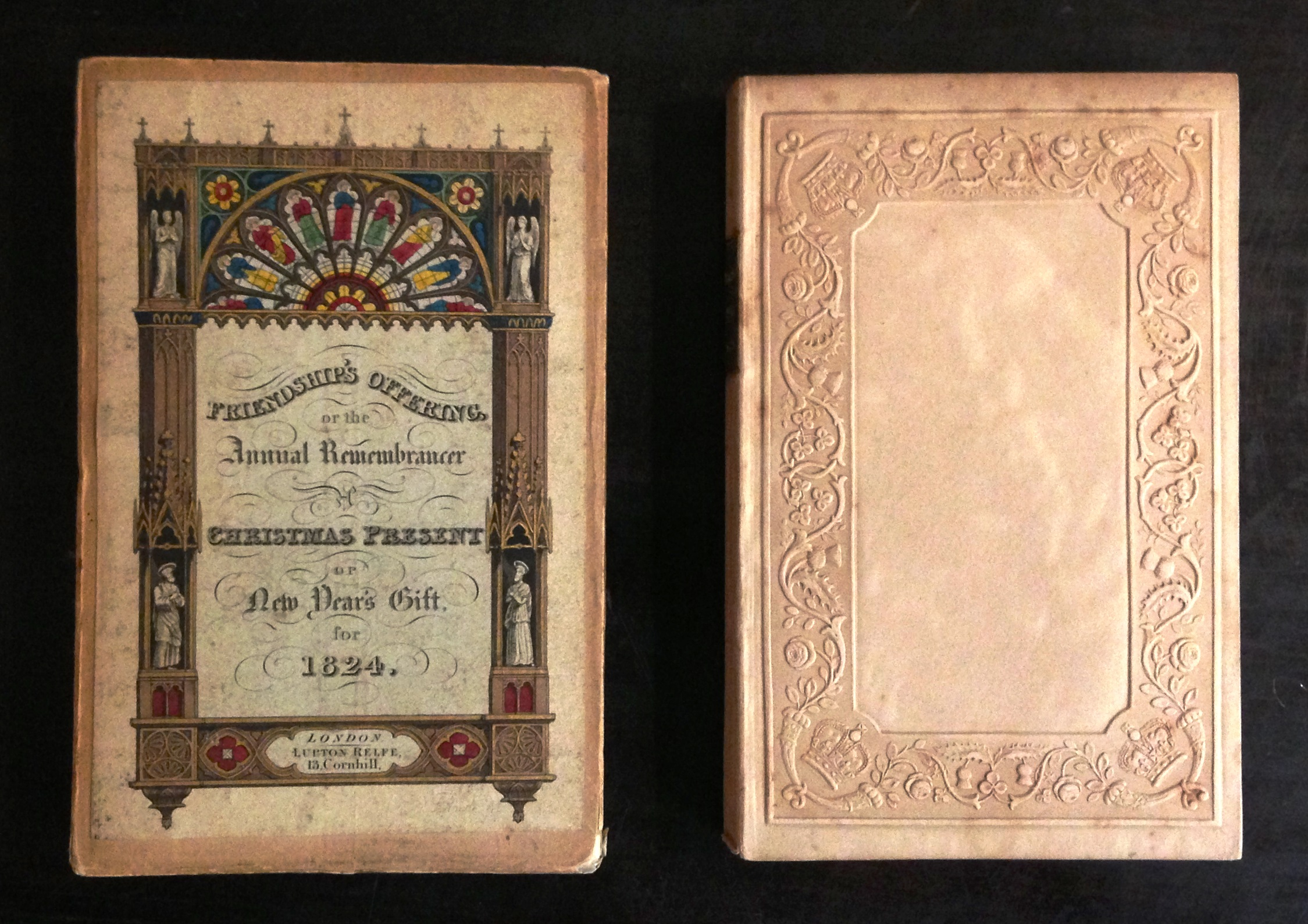 "Friendship's Offering, or the Annual Remembrancer, a Christmas Present or New Year's Gift (London: Lupton Relfe, 1823) was one of the earliest English ""gift books,"" The fragile binding of embossed paper boards was given added protection (and a marketing boost) by a protective cardboard case, onto which was pasted a hand-colored engraved title."