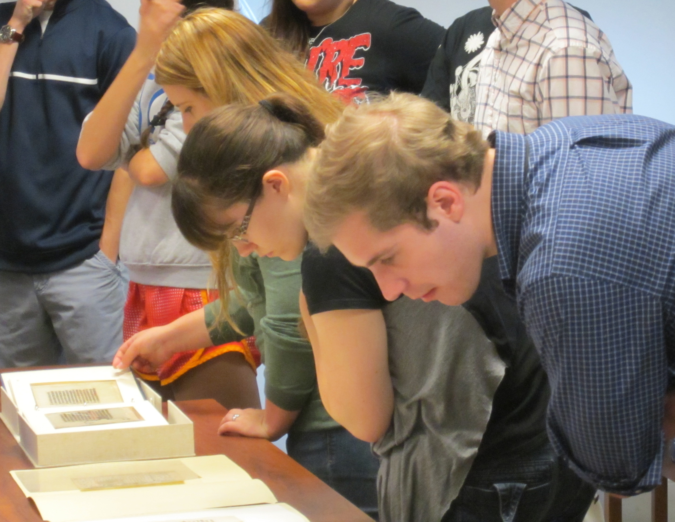 Students take a close look at our medieval manuscripts, featuring the legend of St. Margaret. (Photograph by Petrina Jackson)