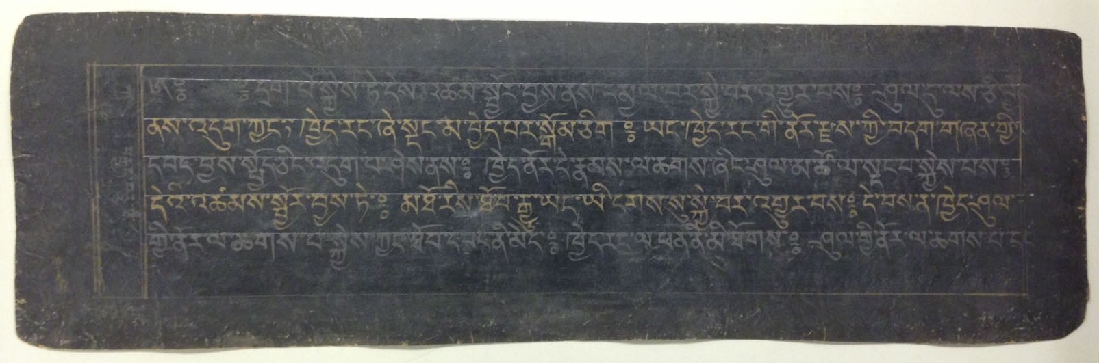 A page from an 18th-century manuscript copy of the Tibetan Book of the Dead. The text is written in alternating gold and silver ink. The blue-black lacquered paper was created by applying a lacquer made of yak-skin glue, animal brains, and soot, which was then burnished to create an appropriate writing surface.   (MSS 14259)