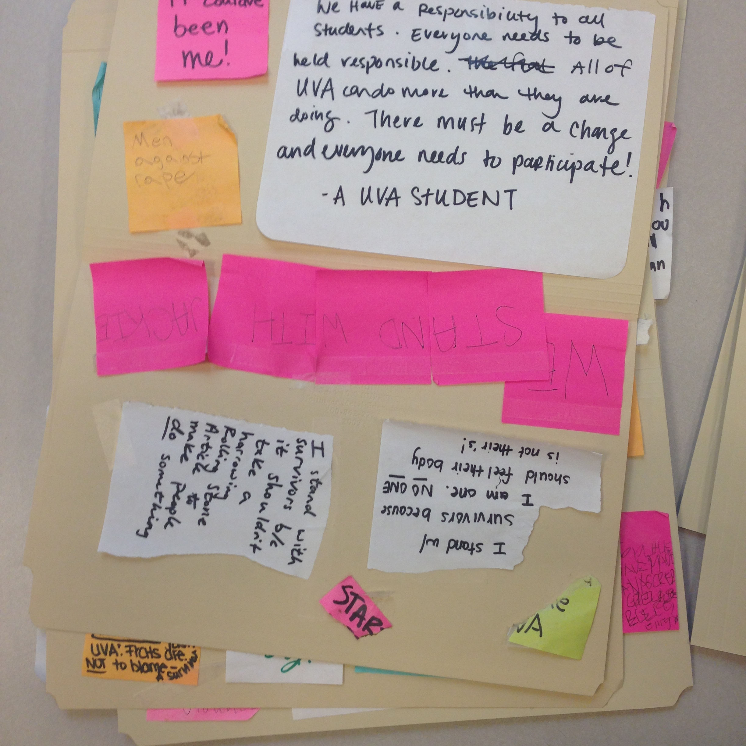 Notes from Peabody Hall door, temporarily housed on archival folders, 10 December 2014. (Photograph by Edward Gaynor)