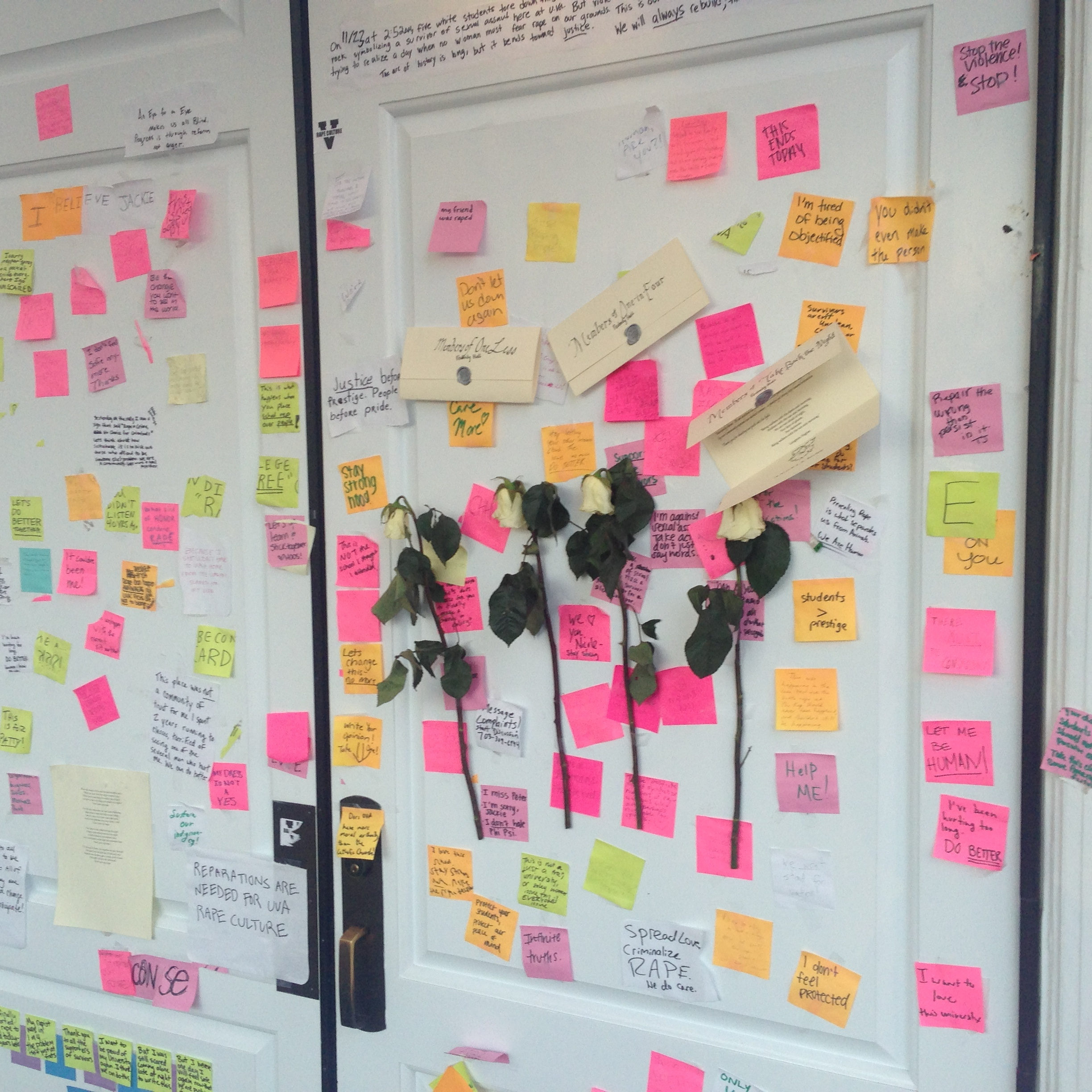 Display of Notes on the doors of Peabody Hall, 10 December 2014. (Photograph taken by Edward Gaynor.).