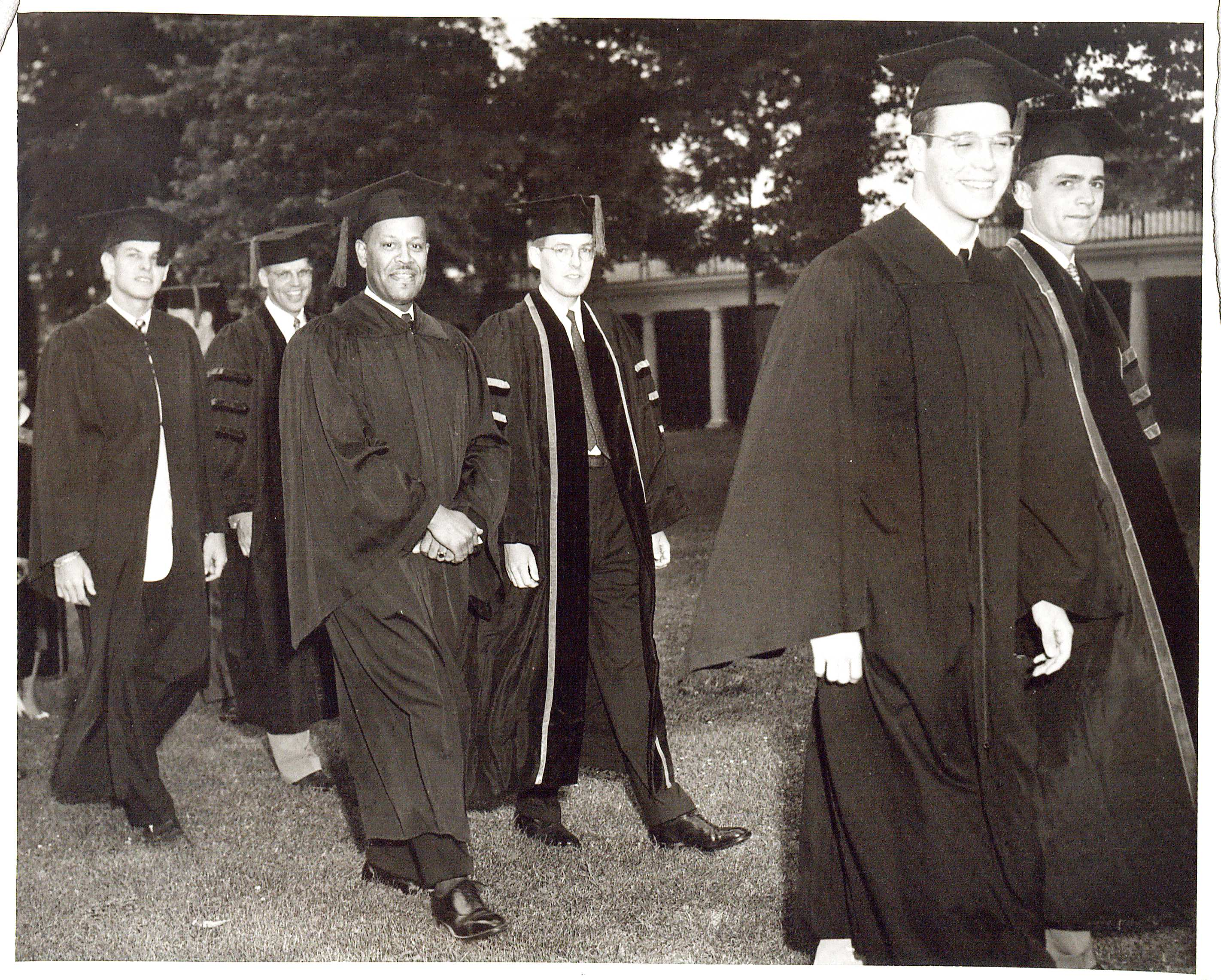 Photograph of UVa Finals, Academic procession. 15 June 1953.  (RG-30/1/10.011) University of Virginia Visual History Collection Here, a photograph of Walter Nathaniel Ridley, the first African American to graduate from the University of Virginia, is captured.  Ridley (center) smiles for a photograph as he walks the Lawn at the Academic Procession of the summer of 1953.  Ridley received a Ph.D. in education.