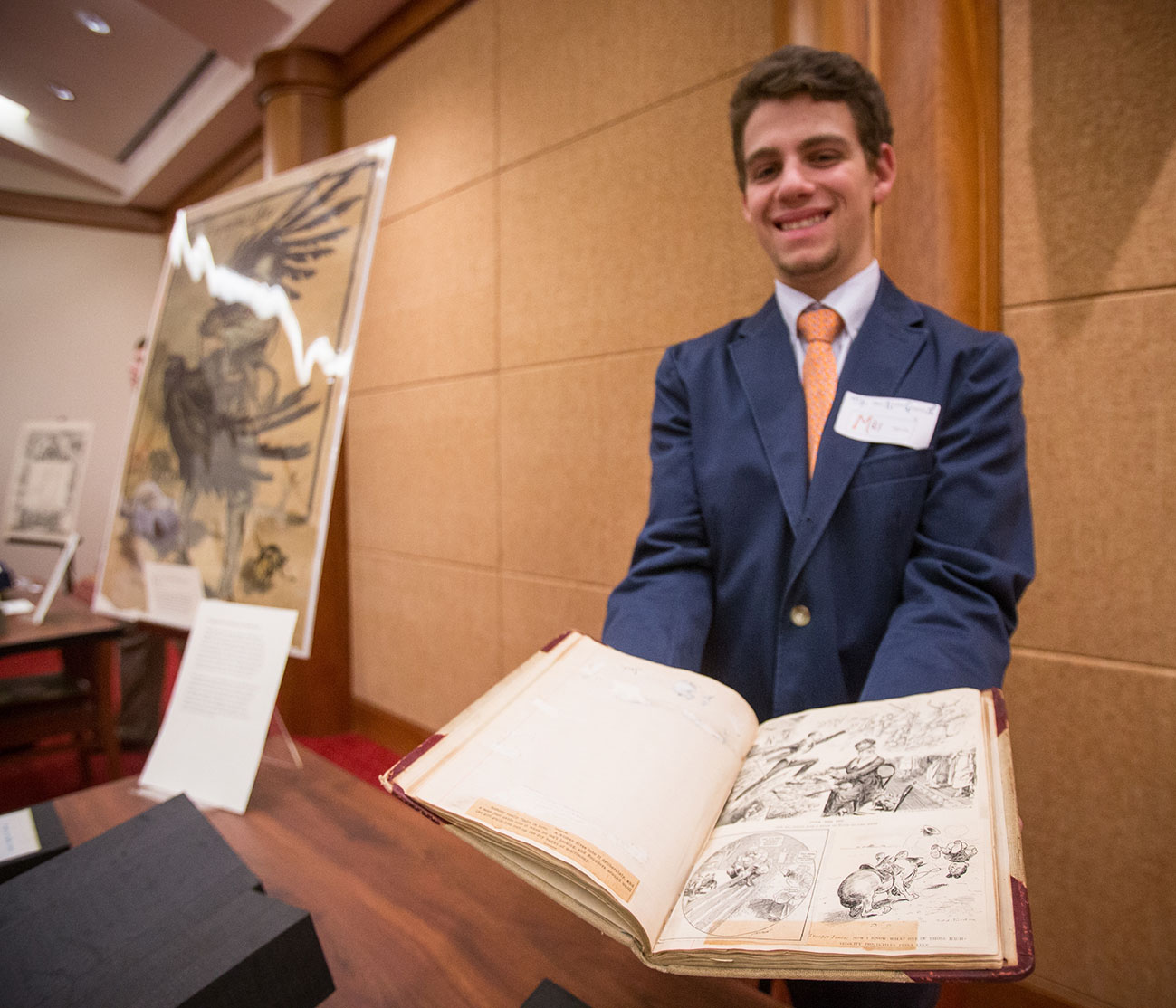 Max Novick presents a WWI era scrapbook, November 18, 2014. (Photograph by Sanjay Suchak)
