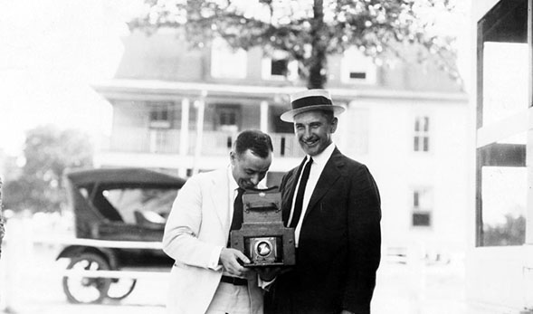 Jackson Davis with camera and an unidentified man (MSS3072, 3072a) Jackson Davis Collection of African American Photographs A photograph taken in 1915 illustrates the use of a camera widely available to the general consumer, which was most likely a Kodak. Cameras at the time would have already started using film and shutters to capture an image. Film is able to retain an image because chemically, it is made with a substance that reacts when struck with a light, namely a flash. The camera revolutionized the way events and people are remembered from a sketch or drawing to a photograph capturing every detail.
