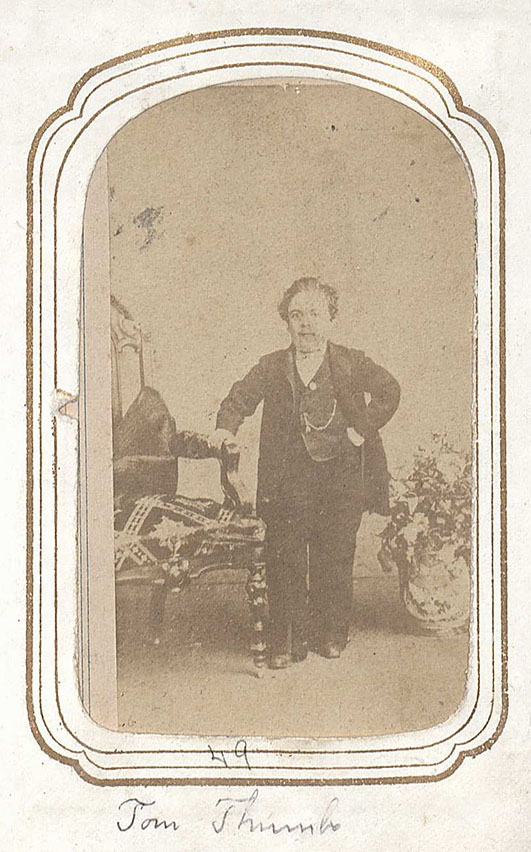 Carte de visite of Tom Thumb from the Photograph Album of Cullen and Graham Family. (MSS 14198). Here is an image of Tom Thumb, a dwarf or little person who was a very popular act in Barnum's circus. Tom Thumb, originally Charles Stratton, was hired as a young boy to the circus. During his act Tom sang songs or dressed up like characters such as cupid or Napoleon Bonaparte. After his circus career Tom married a woman, who was a dwarf, and they lived quite comfortably.