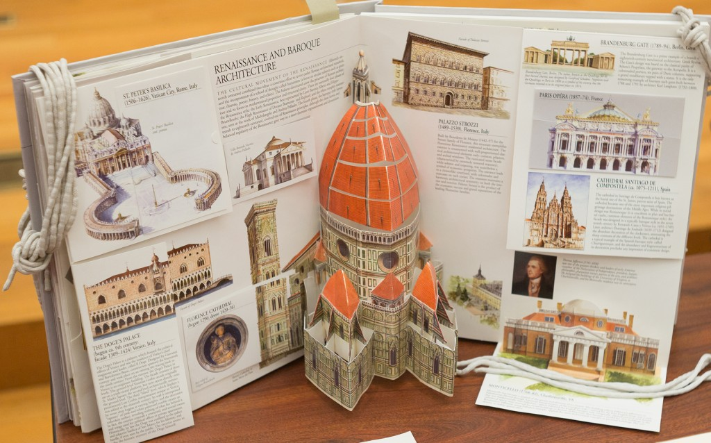 Radevsky, Anton, and Pavel Popov. Architecture Pop-up Book. New York, NY: Universe, 2004. (NA202 .R24 2004) Minor Fund, 2004/2005. This pop up book contains many three dimensional replicas of famous architectural sites. On the page shown, a pop up Palladio and a pop up Monticello are included. Setting the three dimensional models next to each other, although small in scale, one can see the similarities between the two. It is clear that Jefferson's Monticello took inspiration from Palladio, and the model also provides insight into the differences between the two. Overall, this small but accurate 3-D model allows one to experience Monticello as more than just a picture. That which does not appear simply on the page quite literally jumps off of it to show a more detailed artistic description of the building, dimensions, and shape of Monticello. (Photograph by Sanjay Suchak)