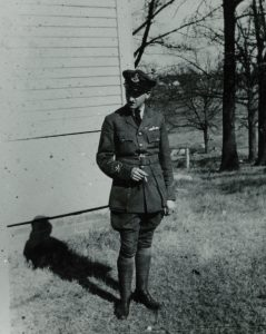 Here Faulkner poses in his uniform with a cigarette.