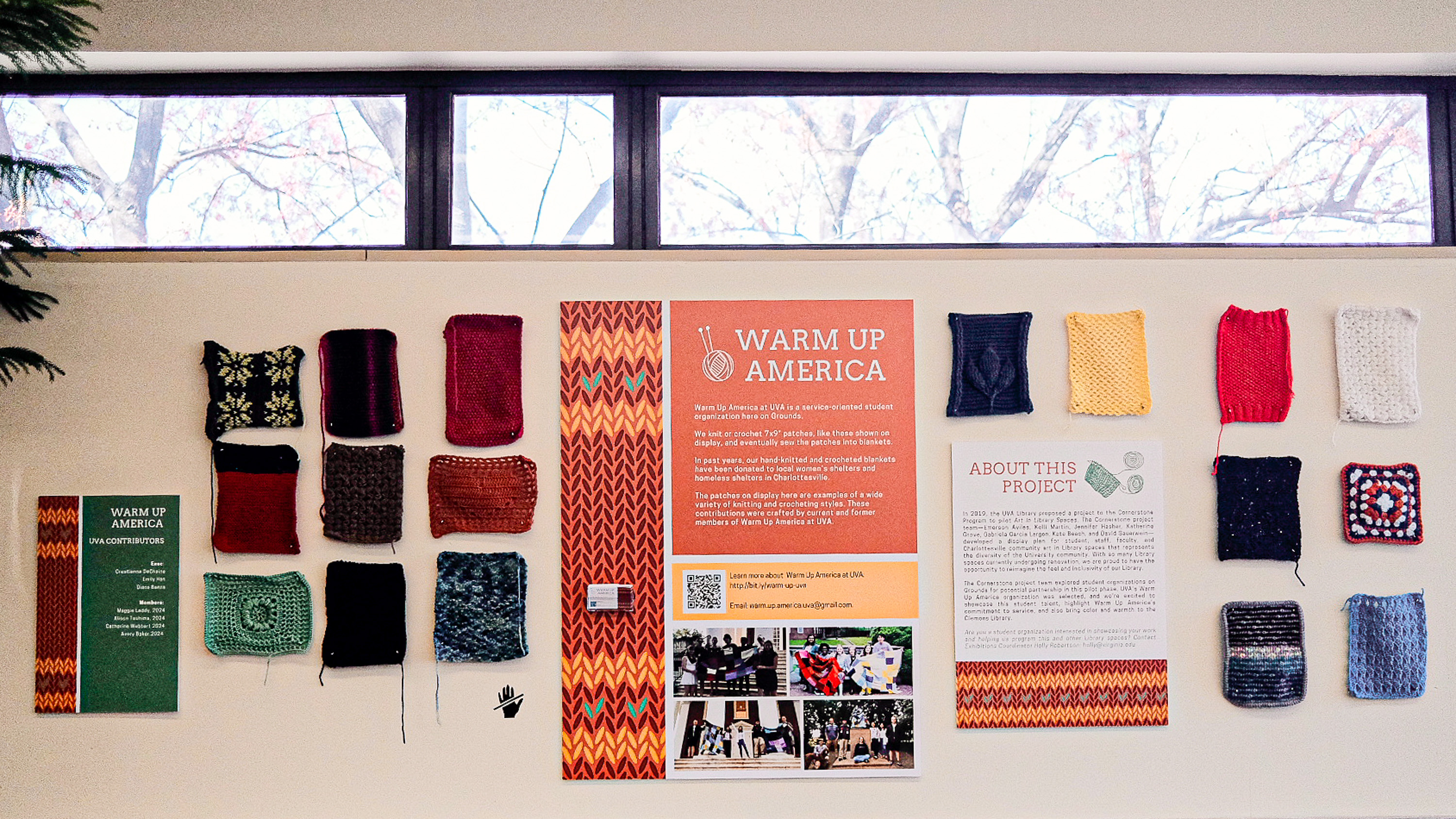 Gallery installation of knit and crochet squares by student organization Warm Up America
