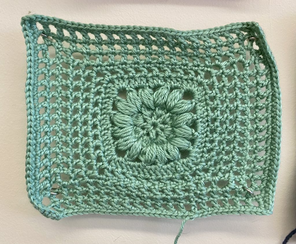 mint green knitted square