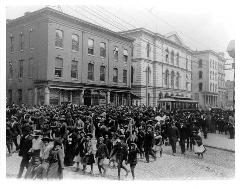 Photograph of Emancipation Day in Richmond, VA April 3, 1905: African Americans walking en masse in street parade